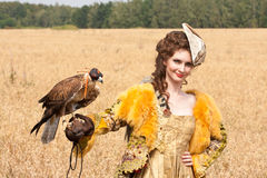 The woman with falcon has a rest Royalty Free Stock Photo