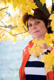 Woman in fall Royalty Free Stock Image