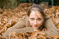 Woman in Fall Leaves Stock Photography