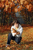 Woman with fall leaves Stock Images