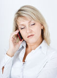 The woman fallen asleep while talking on a cell phon Stock Images