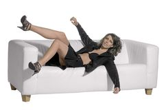 Woman falling on couch Royalty Free Stock Images