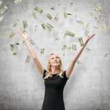 Woman with falling dollars banknote. Woman with hands up on falling dollars banknote Royalty Free Stock Photo