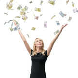 Woman with falling euro bills. Happy woman with hands up on falling euro bills Royalty Free Stock Photo