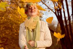 Woman with falling leaves Royalty Free Stock Photography