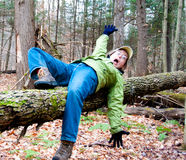 Woman falling off a log Royalty Free Stock Photo