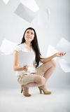 Woman and falling paper Royalty Free Stock Photo