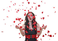 Woman with falling rose petals Royalty Free Stock Photo