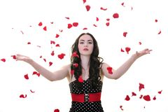 Woman with falling rose petals stock photo