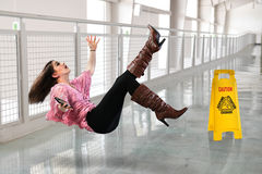 Woman Falling on Wet Floor Royalty Free Stock Photography