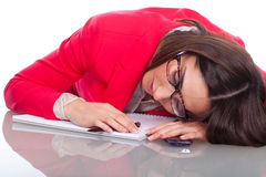 Woman falls asleep on desk Stock Images