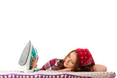 Woman falls asleep while ironing isolated over white background.  Stock Images