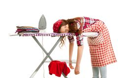 Woman falls asleep while ironing isolated over white background. Exhausted Woman falls asleep while ironing isolated over white background Royalty Free Stock Photography