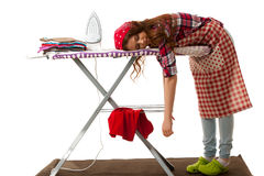 Woman falls asleep while ironing isolated over white background.  Royalty Free Stock Photography