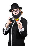 Woman With False Beard And Mustache Holding Cube Puzzle Royalty Free Stock Image