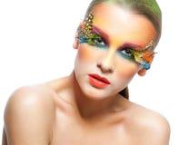 Woman with false feather eyelashes makeup. Young pretty woman face with false feather eyelashes fashion makeup Stock Photography