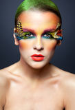 Woman with false feather eyelashes makeup. Young pretty woman face with false feather eyelashes fashion makeup Royalty Free Stock Image