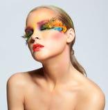 Woman with false feather eyelashes makeup Royalty Free Stock Photo