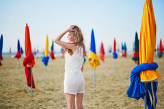 Woman with famous colorful parasols on Deauville Beach in France Stock Image