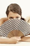 Woman with a fan Stock Photography