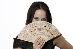 Woman with a fan. In her hand Royalty Free Stock Photo
