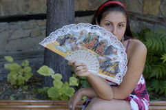 Woman And Fan Royalty Free Stock Photos