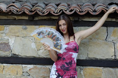 Woman And Fan royalty free stock images