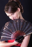 Woman with fan Stock Image