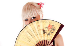 Woman with a fan Royalty Free Stock Photography