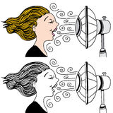 Woman With Fan Blowing. An image of a woman with a fan blowing in her face to cool down Royalty Free Stock Photo