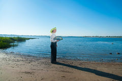 Woman with fan on the coast Stock Photos