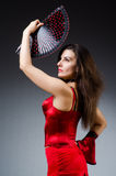 The woman with fan dancing dances Stock Photos