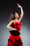 The woman with fan dancing dances Royalty Free Stock Photography