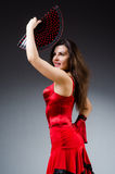 The woman with fan dancing dances Royalty Free Stock Images