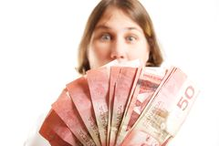 Woman With Fan Of Fifties. Woman slightly out of focus behind a fan of fifty dollar bills Stock Photos