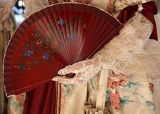 Woman with fan in her hand with glove. Elegant woman with an ancient ceremonial dress and the fan in her hand with white glove Royalty Free Stock Images