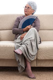 Woman with fan Royalty Free Stock Photography
