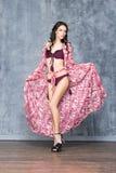 Woman in a fancy swimsuit in a studio Stock Image