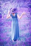 Woman in fantasy garden royalty free stock image