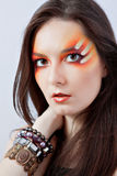 Woman with fantasy red makeup Stock Images