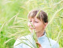 Woman in a farm field. Young woman in a farm field with ripening rye Royalty Free Stock Photo