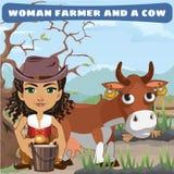 Woman farmer and a cow on the ranch Stock Photos
