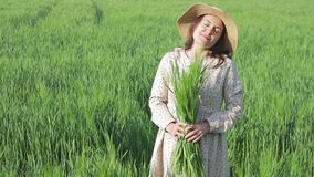 Woman farmer enjoying nature and sun stock video footage