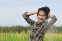Woman farmer in Green Cornfield Stock Photo