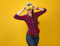 Woman farmer holding apples in the front of face like big eyes Royalty Free Stock Images