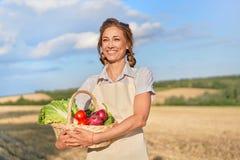 Woman farmer apron standing farmland smiling Female agronomist specialist farming agribusiness Happy positive caucasian worker