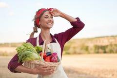 Woman farmer standing farmland smiling Female agronomist specialist farming agribusiness Happy positive caucasian worker