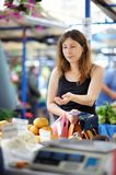 Woman at the farmer market Royalty Free Stock Photography