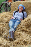 Woman Farmer Resting in Hay. A woman farmer rests in a pile of hay stock images