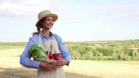 Woman farmer straw hat apron standing farmland smiling Female agronomist specialist farming agribusiness Happy positive